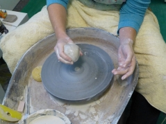 Getting ready to drop clay in centre of the wheel-head