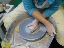 Flattening the clay slightly before opening
