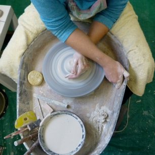 Coning the clay helps to centre it on the wheel