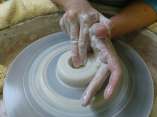 Opening the clay up. I use my index and middle finger to do this, making sure that my hands are locked together