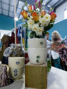 Servant Ceramics' signature altered beakers  and one of our flower arrangements