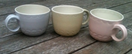 Trio of scooped mugs