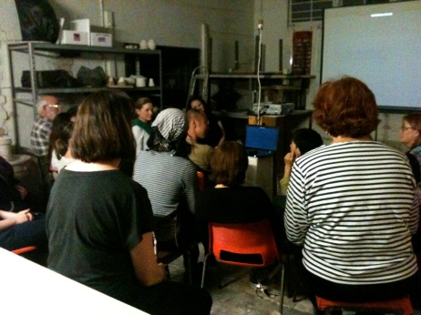 Gathered around the projector, captured by Momoko's stories